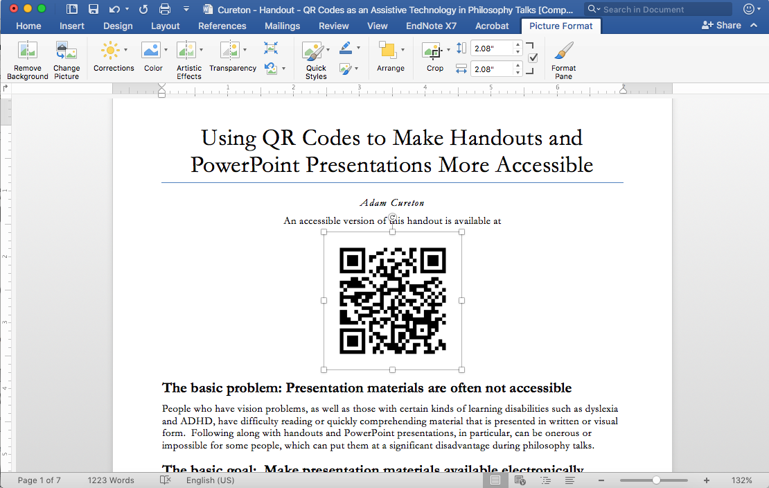 Shows a screenshot of a Mac, after the QR code has been inserted into a Word document.