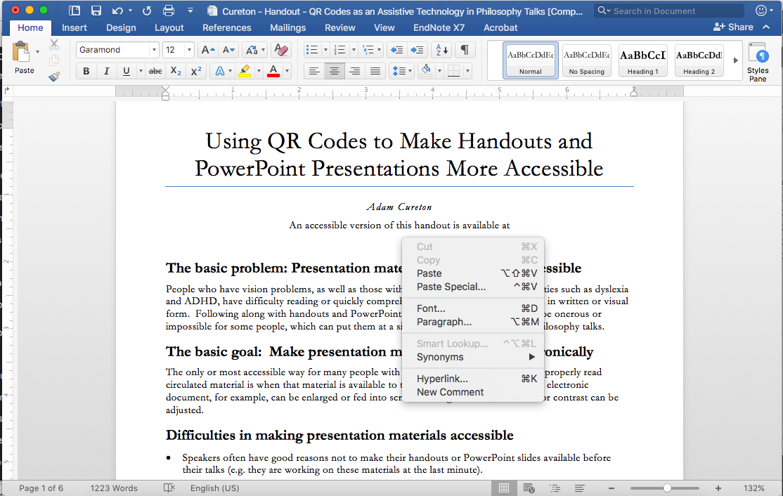 Shows a screenshot of a Mac, right-clicking on an open space in a Word document.
